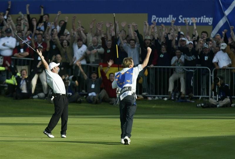 THE BELFRY - 29 SEPTEMBER:  Paul McGinley of Europe celebrates after holing his par putt on the 18th green to halve his match against Jim Furyk in the final day singles and secure victory for Europe in the 34th Ryder Cup matches between Europe and the USA at the De Vere Belfry in Sutton Coldfield, England on September 29, 2002. Europe won 15.5 to 12.5. (photo by Craig Jones/Getty Images)