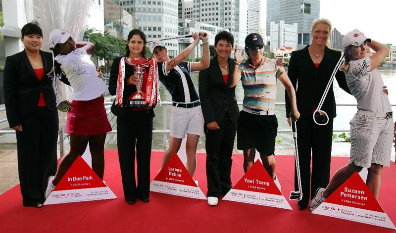 SINGAPORE - MARCH 03:  Inbee Park of South Korea, Lorena Ochoa of Mexico, Yani Tseng of Chinese Taipei and Suzann Pettersen of Norway during a photocall in down town Singapore prior to the HSBC Women's Champions at the Tanah Merah Country Club on March 3, 2009 in Singapore.  (Photo by Ross Kinnaird/Getty Images)