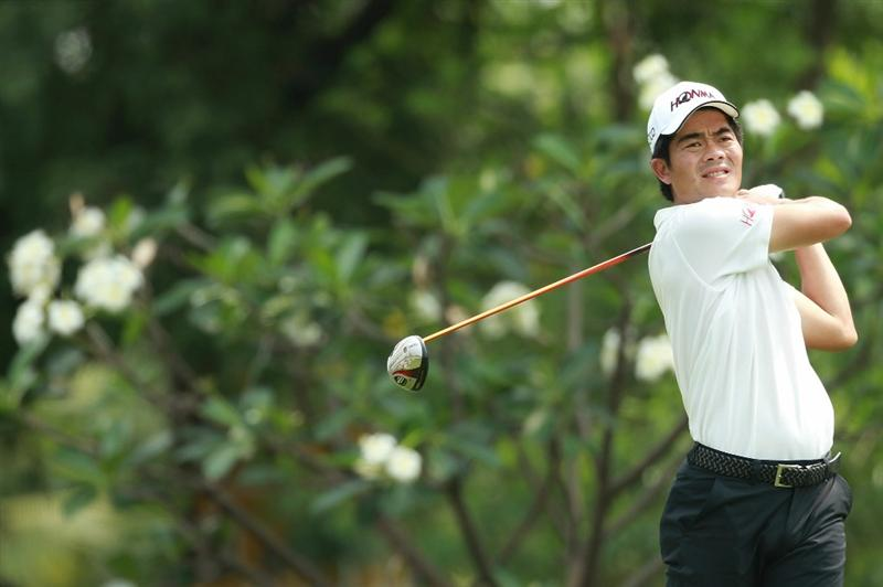 CHON BURI, THAILAND - FEBRUARY 25:  Liang Wen-Chong of China plays his shot on the 8th hole during day two of The Open Championship Asia Final Qualifying tournament at Amata Spring Country Club on February 25, 2011 in Chon Buri, Thailand.  (Photo by Stanley Chou/Getty Images)