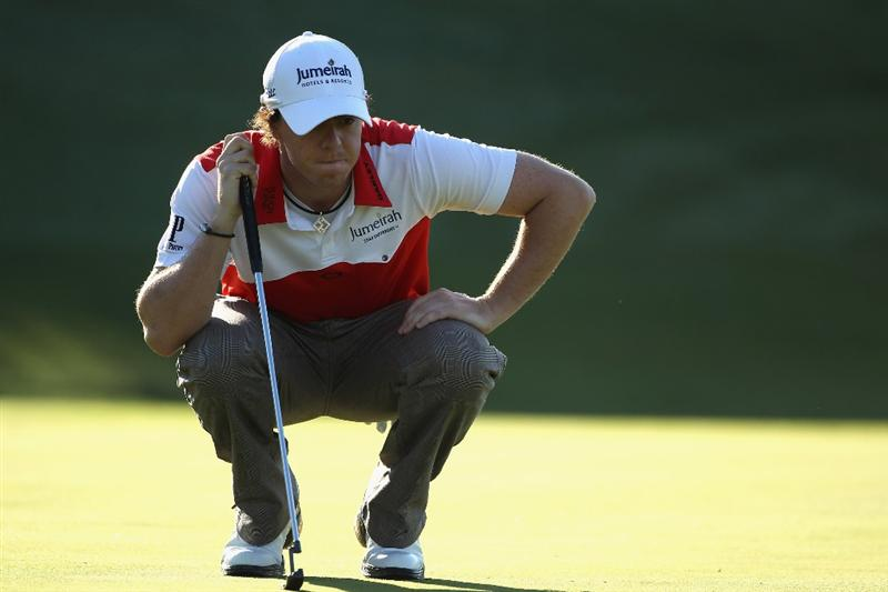 CASARES, SPAIN - MAY 21:  Rory McIlroy of Northern Ireland lines up a putt during his last 16 match of the Volvo World Match Play Championships at Finca Cortesin on May 20, 2011 in Casares, Spain.  (Photo by Warren Little/Getty Images)