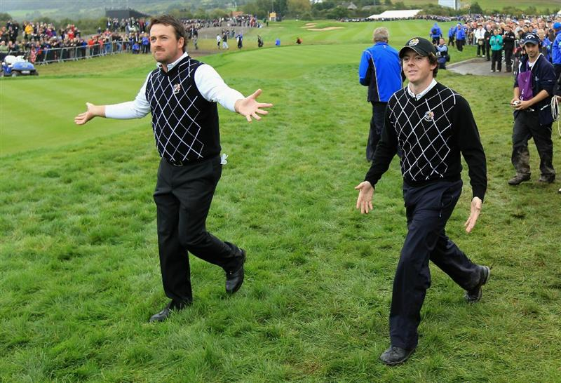 NEWPORT, WALES - OCTOBER 02:  Graeme McDowell (L) and Rory McIlroy walk to the first tee during the rescheduled Afternoon Foursome Matches during the 2010 Ryder Cup at the Celtic Manor Resort on October 2, 2010 in Newport, Wales.  (Photo by David Cannon/Getty Images)