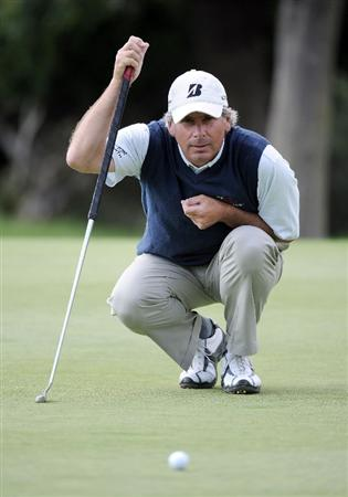 NEWPORT BEACH, CA - MARCH 07:  Fred Couples lines up his putt on the 13th hole during the third round of the Toshiba Classic at the Newport Beach Country Club on March 7, 2010 in Newport Beach, California.  Couples would go on to win the tournament.  (Photo by Harry How/Getty Images)