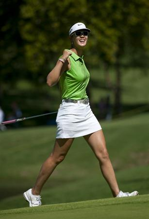 ROGERS, AR - SEPTEMBER 11:  Michelle Wie celebrates an eagle putt on the 18th green during the second round of the P&G NW Arkansas Championship at the Pinnacle Country Club on September 11, 2010 in Rogers, Arkansas.  (Photo by Robert Laberge/Getty Images)