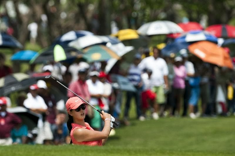 CHON BURI, THAILAND - FEBRUARY 20:  Michelle Wie of USA plays a bunker shot on the 1st hole during day four of the LPGA Thailand at Siam Country Club on February 20, 2011 in Chon Buri, Thailand.  (Photo by Victor Fraile/Getty Images)
