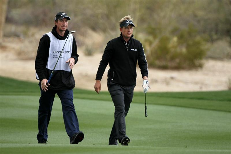 MARANA, AZ - FEBRUARY 27:  Luke Donald of England (R) walks with caddie John McLaren (L) on the second hole during the final round of the Accenture Match Play Championship at the Ritz-Carlton Golf Club on February 27, 2011 in Marana, Arizona.  (Photo by Andy Lyons/Getty Images)