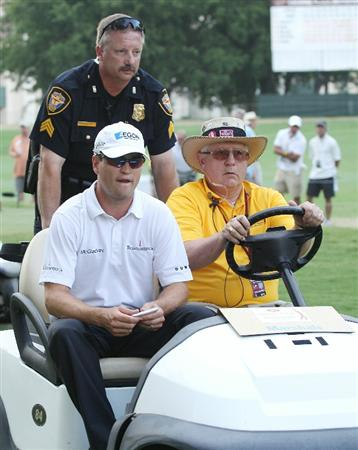 FT. WORTH, TX - MAY 30:  Zach Johnson is taken off the 18th hole after play was suspended by dangerous weather during the final round of the 2010 Crowne Plaza Invitational at the Colonial Country Club on May 30, 2010 in Ft. Worth, Texas.  (Photo by Scott Halleran/Getty Images)