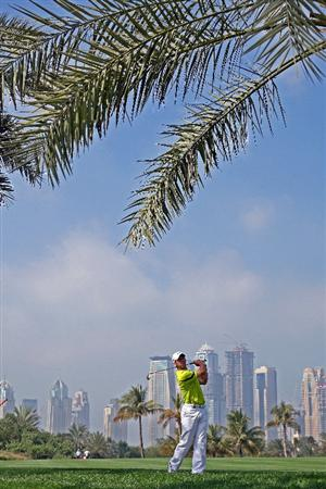 DUBAI, UNITED ARAB EMIRATES - JANUARY 29: Paul Casey of England hits his second shot at the par 5, 13th hole during the first round of the 2009 Dubai Desert Classic on the Majilis Course at the Emirates Golf Club on January 29, 2009 in Dubai, United Arab Emirates  (Photo by David Cannon/Getty Images)