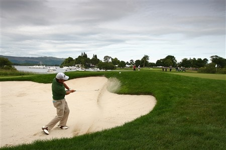 LUSS, UNITED KINGDOM - JULY 13:  Graeme McDowell of Northern Ireland hits out of a bunker on to the 17th green on his way to victory during the Final Round of The Barclays Scottish Open at Loch Lomond Golf Club on July 13, 2008 in Luss, Scotland.  (Photo by Richard Heathcote/Getty Images)