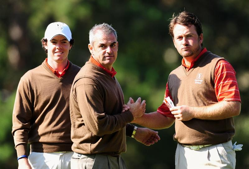 PARIS - SEPTEMBER 26:  Rory McIlroy and Graeme McDowell are congratulated by the Captain of the Great Britian and Northern Ireland team, Paul McGinley during the third day morning greensomes at The Vivendi Trophy with Severiano Ballesteros at Saint - Nom - La Breteche golf course on September 26, 2009 in Paris, France.  (Photo by Stuart Franklin/Getty Images)