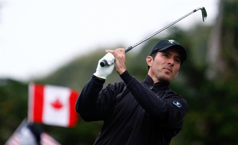 SAN FRANCISCO - OCTOBER 11:  Mike Weir of the International Team watches his tee shot on the second hole during the Final Round Singles Matches of The Presidents Cup at Harding Park Golf Course on October 11, 2009 in San Francisco, California.  (Photo by Scott Halleran/Getty Images)