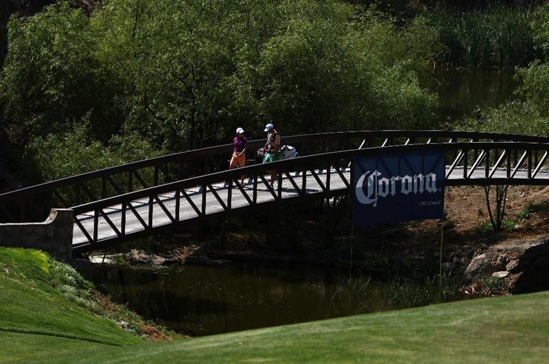 MORELIA, MEXICO- APRIL 23:  Lorena Ochoa of Mexico and caddie walk across a bridge during the first round of the Corona Championship at the Tres Marias Residential Golf Club on April 23, 2009 in Morelia, Michoacan, Mexico. (Photo by Donald Miralle/Getty Images)