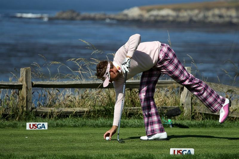 PEBBLE BEACH, CA - JUNE 17:  Ian Poulter of England tees up his golf ball on the fifth hole during the first round of the 110th U.S. Open at Pebble Beach Golf Links on June 17, 2010 in Pebble Beach, California.  (Photo by Ross Kinnaird/Getty Images)