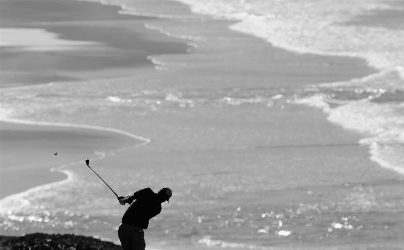 PEBBLE BEACH, CA - FEBRUARY 11:  (EDITOR'S NOTE: This digital image has been converted to black and white).  Padraig Harrington of Ireland plays his approach shot on the nineth hole during the second round of the AT&T Pebble Beach National Pro-Am at the Pebble Beach Golf Links on February 11, 2011  in Pebble Beach, California  (Photo by Stuart Franklin/Getty Images)
