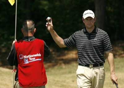 Justin Bolli waves to the gallery after a par putt on the sixth green during the final round of the 2007 Athens Regional Foundation Classic Sunday, April 22, 2007, at the Jennings Mill Country Club in Bogart, Georgia. Nationwide Tour - 2007 Athens Regional Foundation Classic - Final RoundPhoto by Kevin C.  Cox/WireImage.com