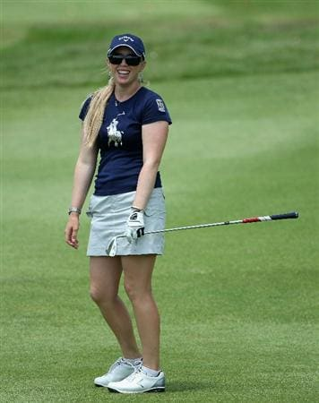 SINGAPORE - FEBRUARY 26:  Morgan Pressel of the USA smiles on the 16th hole during the third round of the HSBC Women's Champions at the Tanah Merah Country Club on February 26, 2011 in Singapore.  (Photo by Andrew Redington/Getty Images)