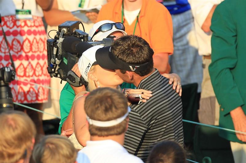 AUGUSTA, GA - APRIL 10:  Charl Schwartzel of South Africa celebrates his two-stroke victory with his wife Rosalind behind the 18th green during the final round of the 2011 Masters Tournament at Augusta National Golf Club on April 10, 2011 in Augusta, Georgia.  (Photo by David Cannon/Getty Images)