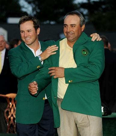 AUGUSTA, GA - APRIL 12:  Trevor Immelman of South Africa presents Angel Cabrera of Argentina with the green jacket during the green jacket presentation after Cabrera defeated Kenny Perry on the second sudden death playoff hole to win the 2009 Masters Tournament at Augusta National Golf Club on April 12, 2009 in Augusta, Georgia.  (Photo by Harry How/Getty Images)