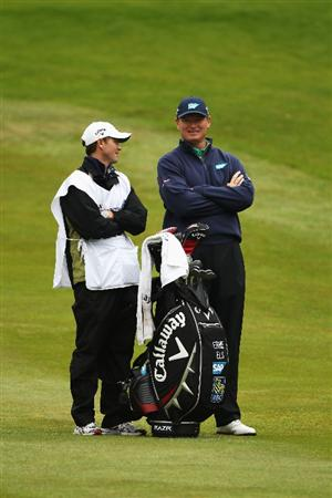 VIRGINIA WATER, ENGLAND - MAY 27:  Ernie Els of South Africa chats with his caddie Michael Kerr during the second round of the BMW PGA Championship at the Wentworth Club on May 27, 2011 in Virginia Water, England.  (Photo by Warren Little/Getty Images)