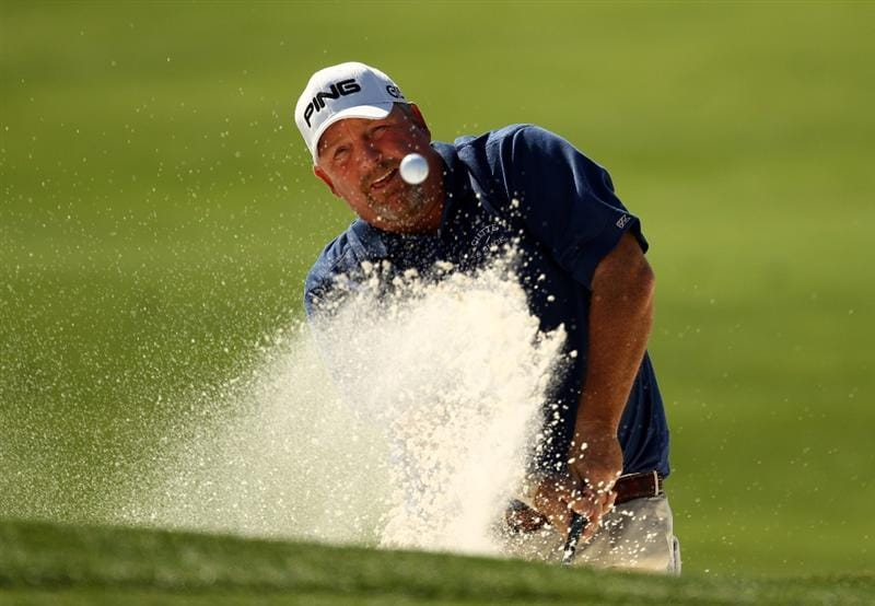CHARLOTTE, NC - APRIL 29:  Mark Calcavecchia plays from a greenside bunker on the 5th during the first round of the Quail Hollow Championship at Quail Hollow Country Club on April 29, 2010 in Charlotte, North Carolina.  (Photo by Richard Heathcote/Getty Images)