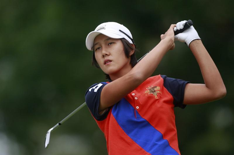 ROGERS, AR - SEPTEMBER 13:  Song-Hee Kim of South Korea watches her tee shot on the third hole during final round play in the P&G Beauty NW Arkansas Championship at the Pinnacle Country Club on September 13, 2009 in Rogers, Arkansas.  (Photo by Dave Martin/Getty Images)