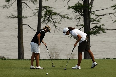 WILLIAMSBURG, VA - MAY 12:  Sarah Lee (R) of South Korea and Becky Morgan of Wales (L) play on the 16th green in Round 3 of the LPGA Michelob ULTRA Open at Kingsmill on May 12, 2007, in Williamsburg, Virginia.  (Photo by Jonathan Ernst/Getty Images)