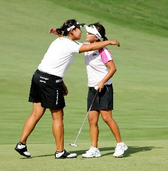 NEW ROCHELLE, NY - JULY 21:  Mi Hyun Kim (R) and Jee Young Lee of South Korea embrace after Kim wins during the quarter finals of the HSBC Women's World Match Play Championship at Wykagyl County Club on July 21, 2007 in New Rochelle, New York.  (Photo by Richard Heathcote/Getty Images)
