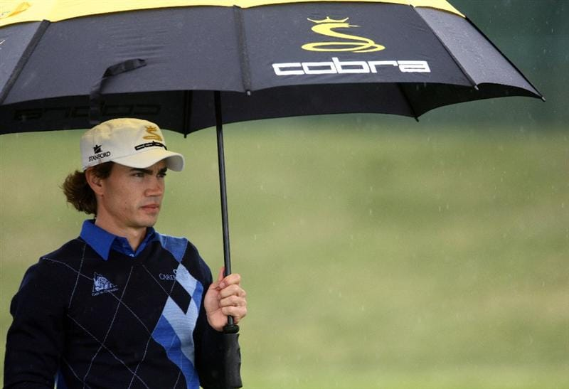 LA JOLLA, CA - FEBRUARY 05:  Camilo Villegas of Colombia takes cover on the 18th fairway during the 1st Round of the Buick Invitational at the Torrey Pines North Course on February 5, 2009 in La Jolla, California. (Photo by Donald Miralle/Getty Images)