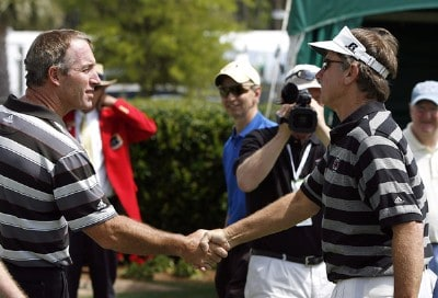 Peter Lonard (left) greets South Carolina head football coach Steve Spurrier (right) before teeing off in the Pro-Am Wednesday, April 12, 2006, at Harbour Town Golf Links in Hilton Head Island, South Carolina.Photo by Kevin C.  Cox/WireImage.com