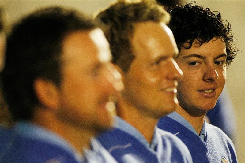 NEWPORT, WALES - SEPTEMBER 29:  Rory McIlroy (R) of Europe looks on during the European Team Photocall prior to the 2010 Ryder Cup at the Celtic Manor Resort on September 29, 2010 in Newport, Wales.  (Photo by Sam Greenwood/Getty Images)