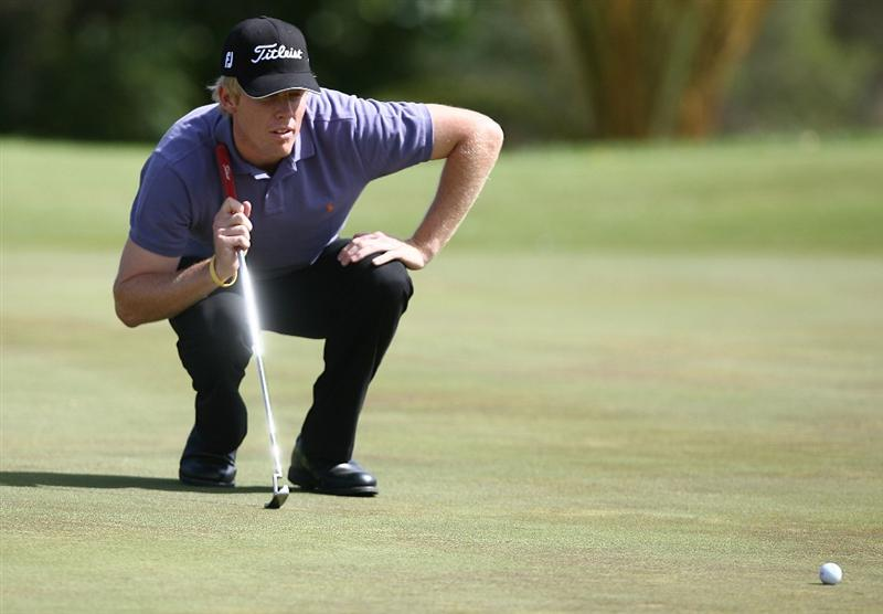 PERTH, AUSTRALIA - FEBRUARY 21:  Andrew Dodt of Australia lines up his putt on the 4th green during round three of the 2009 Johnnie Walker Classic at The Vines Resort and Country Club on February 21, 2009 in Perth, Australia.  (Photo by Paul Kane/Getty Images)