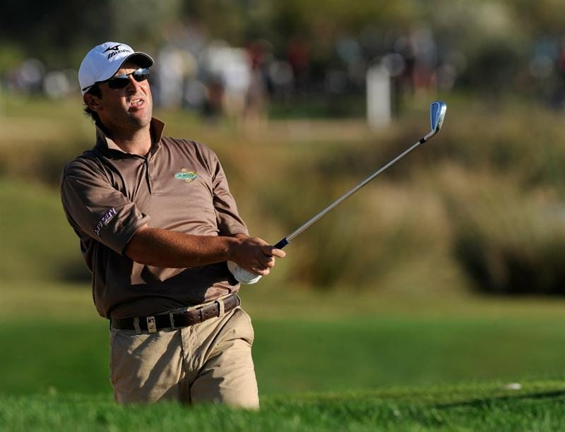 VILAMOURA, PORTUGAL - OCTOBER 16:  David Dixon of England plays his approach shot on the 18th hole during the third round of the Portugal Masters at the Oceanico Victoria Golf Course on October 16, 2010 in Villamoura, Portugal.  (Photo by Stuart Franklin/Getty Images)