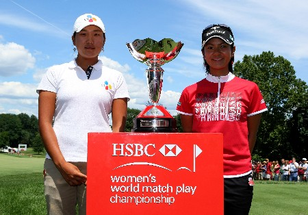 NEW ROCHELLE, NY - JULY 22:  Seon Hwa Lee of South Korea (L) and Ai Miyazato of Japan pose with the trophy before the start of the final of the HSBC Women's World Match Play Championship at Wykagyl County Club on July 22, 2007 in New Rochelle, New York.  (Photo by Richard Heathcote/Getty Images)