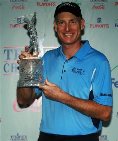 ATLANTA - SEPTEMBER 26:  Jim Furyk celebrates with THE TOUR Championship trophy after winning THE TOUR Championship presented by Coca-Cola, the final event of the PGA TOUR Playoffs for the FedExCup, at East Lake Golf Club on September 26, 2010 in Atlanta, Georgia.  (Photo by Scott Halleran/Getty Images)