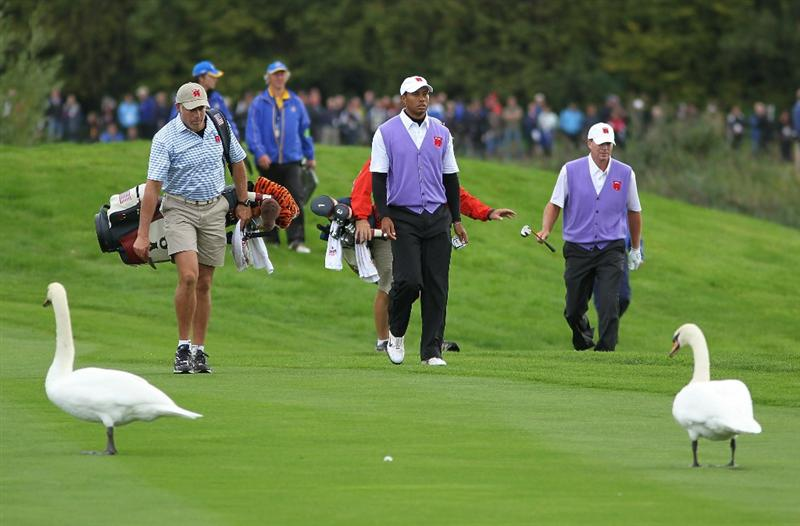 NEWPORT, WALES - OCTOBER 02:  Tiger Woods of the USA walks down the 11th hole with Steve Stricker (R) during the rescheduled Afternoon Foursome Matches during the 2010 Ryder Cup at the Celtic Manor Resort on October 2, 2010 in Newport, Wales.  (Photo by Jamie Squire/Getty Images)