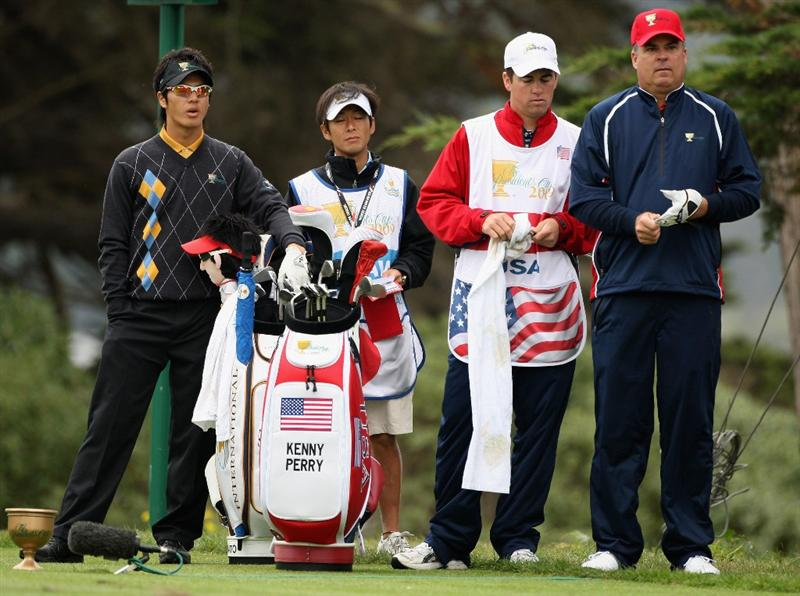 SAN FRANCISCO - OCTOBER 11:  Ryo Ishikawa of the International Team stands with Kenny Perry of the USA Team during the Day Four Singles Matches of The Presidents Cup at Harding Park Golf Course on October 11, 2009 in San Francisco, California.  (Photo by Warren Little/Getty Images)