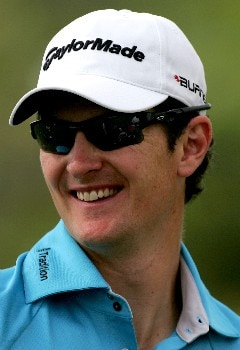 PALM BEACH GARDENS, FL - MARCH 01:  Justin Rose of England talks with his caddie during the third round of the Honda Classic at PGA National Resort and Spa on March 1, 2008 in Palm Beach Gardens, Florida.  (Photo by Sam Greenwood/Getty Images)