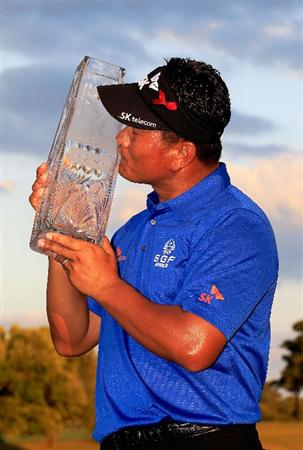 PONTE VEDRA BEACH, FL - MAY 15:  K.J. Choi of South Korea celebrates with the trophy after defeating David Toms on the first playoff hole to win THE PLAYERS Championship held at THE PLAYERS Stadium course at TPC Sawgrass on May 15, 2011 in Ponte Vedra Beach, Florida.  (Photo by Sam Greenwood/Getty Images)
