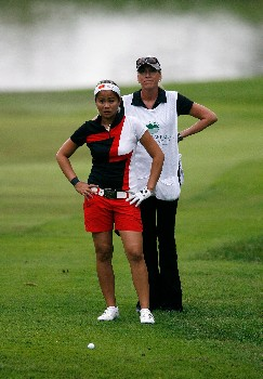 ROGERS, AR - SEPTEMBER 7:  Jennifer Rosales and her caddie look at the path she has to the eighth green during the first round of the 2007 LPGA NW Arkansas Championship presented by John Q. Hammons at Pinnacle Country Club September 7, 2007 in Rogers, Arkansas.  (Photo by Kevin C. Cox/Getty Images)