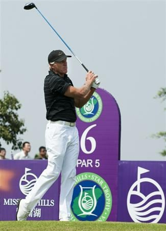 HAIKOU, CHINA - OCTOBER 30:  Golf legend Greg Norman of Australia tees off on the 6th hole during day four of the Mission Hills Start Trophy tournament at Mission Hills Resort on October 30, 2010 in Haikou, China. The Mission Hills Star Trophy is Asia's leading leisure liflestyle event and features Hollywood celebrities and international golf stars.  (Photo by Victor Fraile/Getty Images for Mission Hills)