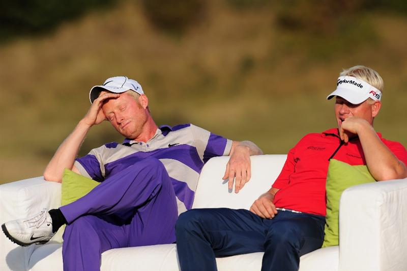 ZANDVOORT, NETHERLANDS - AUGUST 23:  Simon Dyson of England and Peter Hedblom of Sweden ponder after the final round of The KLM Open at Kennemer Golf & Country Club on August 23, 2009 in Zandvoort, Netherlands.  (Photo by Stuart Franklin/Getty Images)