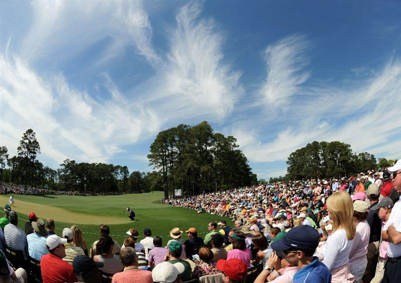 AUGUSTA, GA - APRIL 10:  Patrons watch as K.J. Choi of South Korea lines up a putt on the second green during the third round of the 2010 Masters Tournament at Augusta National Golf Club on April 10, 2010 in Augusta, Georgia.  (Photo by Harry How/Getty Images)