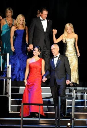 CARDIFF, WALES - SEPTEMBER 29:  Corey Pavin and his wife Lisa Pavin, along with members of the United States Ryder Cup team, walk onstage during Welcome To Wales at Millennium Stadium on September 29, 2010 in Cardiff, Wales.  (Photo by Eamonn McCormack/Getty Images)