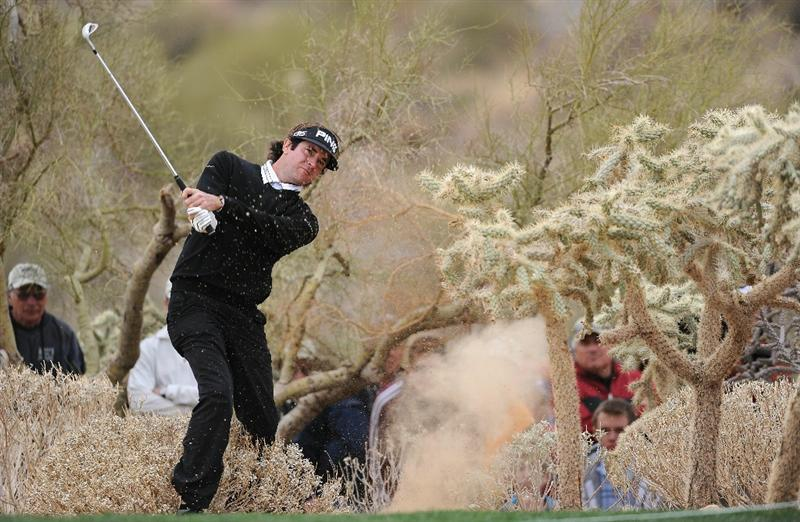 MARANA, AZ - FEBRUARY 26:  Bubba Watson plays his approach shot from the cactus on the 15th hole during the semifinal round of the Accenture Match Play Championship at the Ritz-Carlton Golf Club on February 26, 2011 in Marana, Arizona.  (Photo by Stuart Franklin/Getty Images)