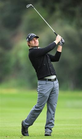 PACIFIC PALISADES, CA - FEBRUARY 18:  Ryan Moore plays his approach shot on the 13th hole during the second round of the Northern Trust Open at Riviera Country Club on February 18, 2011 in Pacific Palisades, California.  (Photo by Stuart Franklin/Getty Images)