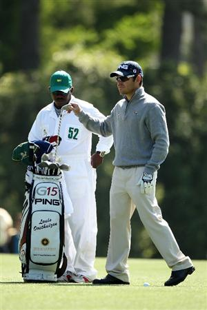 AUGUSTA, GA - APRIL 09:  Louis Oosthuizen of South Africa (R) pulls a club from his bag on the fifth hole alongside caddie Zacharia Rasego during the second round of the 2010 Masters Tournament at Augusta National Golf Club on April 9, 2010 in Augusta, Georgia.  (Photo by Andrew Redington/Getty Images)