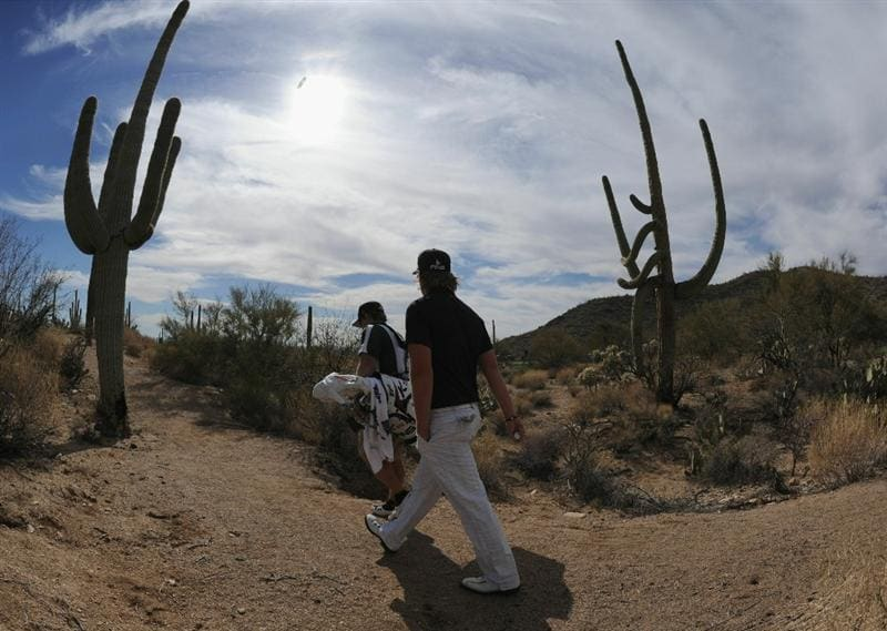 MARANA, AZ - FEBRUARY 25:  Hunter Mahan and caddie walk between the cactus during the third round of the Accenture Match Play Championship at the Ritz-Carlton Golf Club on February 25, 2011 in Marana, Arizona.  (Photo by Stuart Franklin/Getty Images)