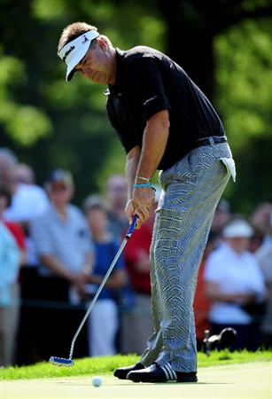 AKRON, OH - AUGUST 06:  Kenny Perry of the U.S. putts on the 13th hole during the first round of the World Golf Championship Bridgestone Invitational on August 6, 2009 at Firestone Country Club in Akron, Ohio.  (Photo by Stuart Franklin/Getty Images)