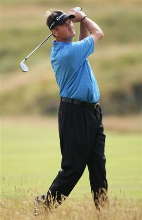 TURNBERRY, SCOTLAND - JULY 16:  Todd Hamilton of USA hits an approach shot during round one of the 138th Open Championship on the Ailsa Course, Turnberry Golf Club on July 16, 2009 in Turnberry, Scotland.  (Photo by Andrew Redington/Getty Images)