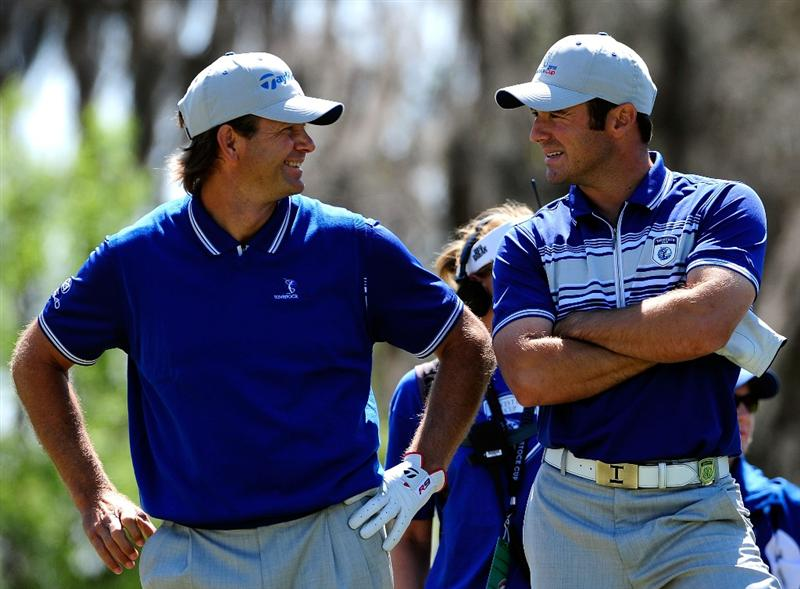 ORLANDO, FL - MARCH 23:  Retief Goosen (L) and Trevor Immelman of South Africa discuss strategy during the second day's play of the Tavistock Cup at Isleworth Golf and Country Club on March 23, 2010 in Orlando, Florida.  (Photo by Sam Greenwood/Getty Images)