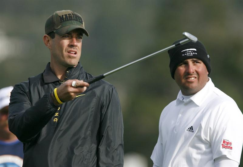PEBBLE BEACH, CA - FEBRUARY 14: Actor Carson Daly and Pat Perez look at the crownd on the 18th hole at Pebble Beach Golf Course during the third round of the AT&T Pebble Beach National Pro-Am on February 14, 2009 in Pebble Beach, California. (Photo by Max Morse/Getty Images for Kodak)